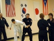 Black Belt Teaching White Belt Martial Arts